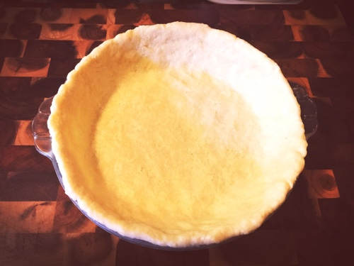 Pie plate lined and ready to be filled
